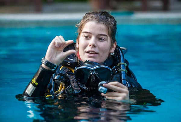 Woman in Professional Diving instructing her students